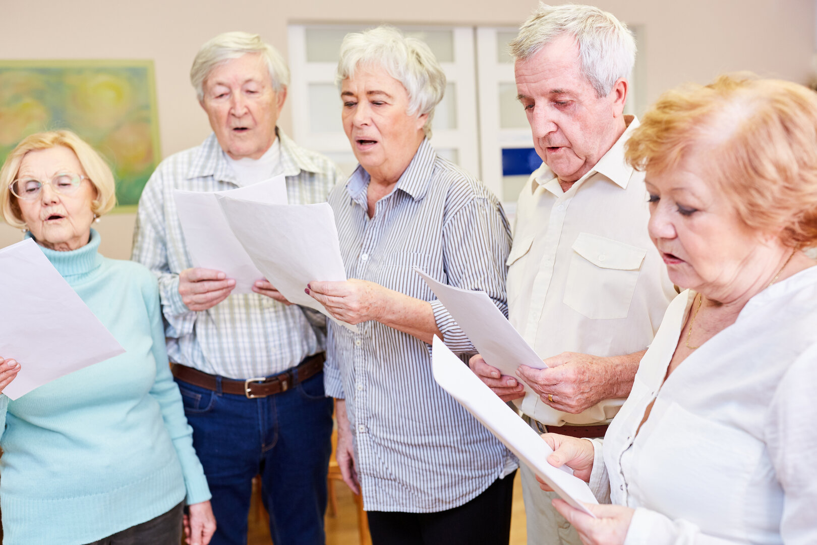 Seniors group sings together in a choir in their free time or as a dementia therapy